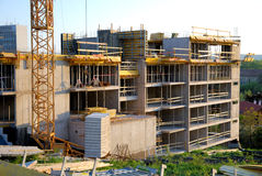 Builnding construction. Building construction - concrete walls, crane and building accessories royalty free stock photo