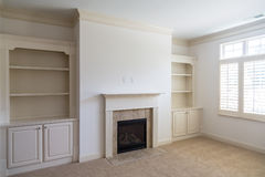 Built-In Bookcases in Empty Room royalty free stock photos