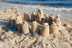 Built castle of sand on the beach of the ocean on a clear summer day a clear sunny summer. Day royalty free stock images
