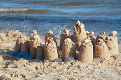 Built castle of sand on the beach of the ocean on a clear summer day a clear sunny summer. Day royalty free stock image