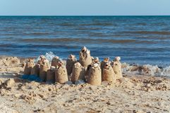 Built castle of sand on the beach of the ocean on a clear summer day a clear sunny summer. Day stock image