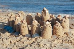 Built castle of sand on the beach of the ocean on a clear summer day a clear sunny summer. Day royalty free stock photos