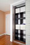 Built-in closet with sliding door shelving storage organization Royalty Free Stock Images
