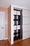 Built-in closet with sliding door shelving storage organization Royalty Free Stock Image