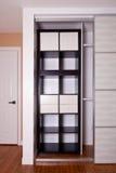 Built-in closet with sliding door shelving storage organization Royalty Free Stock Photos