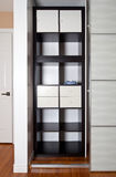 Built-in closet with sliding door shelving storage organization Stock Photo
