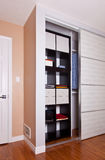 Built-in closet with sliding door shelving storage organization Royalty Free Stock Photo