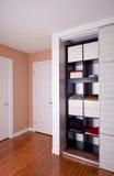 Built-in closet with sliding door shelving storage organization Stock Image