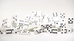 Built figure of dominoes falling in slow motion stock video