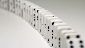 Built figure of dominoes falling in slow motion stock video footage