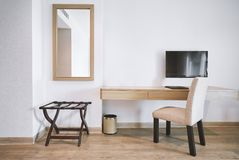 Built-in furniture in the modern hotel apartment room with chair, mirror stock image
