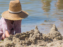 Built House sand castle with towers on the south shore of the sandy beach blue sea Royalty Free Stock Photo