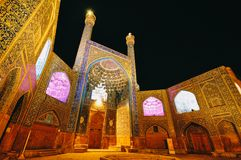 Built jewlery of persian architecture in Isfahan. The royal Mosque or Imam Mosque at night. Persian architecture in islamic era, UNESCO heritage. Elaborate tiled royalty free stock photo