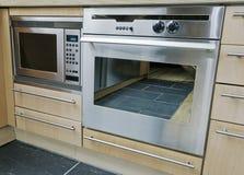 Built in kitchen appliances. Modern built in kitchen appliances in stainless steel Stock Photo