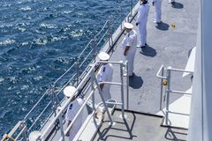 Built sailors in a row in white uniform and white hats built on the deck of a NATO ship troop in the Black Sea/Bulgaria/07.19.208/. A military warship and royalty free stock image