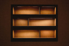 Built-in shelves with light, dark space, decoration Royalty Free Stock Images