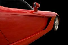 Built For Speed. Red sportscars front end isolated on a black background Royalty Free Stock Images
