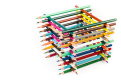 Built square construction of various colored crayons Stock Image