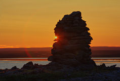Built from stone Cairn at sunset, at midnight, the polar day Royalty Free Stock Photo