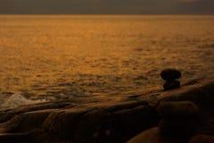 Built stone inukshuk statue on the sea coast Stock Photo