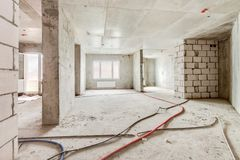Construction site of residential apartment building interior in progress with windows and white brick wall. Built structure construction site of residential royalty free stock photos