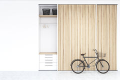 Built in wadrobe in a room with bike Royalty Free Stock Photo