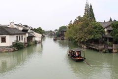 Built on the water's edge rows of houses. Rows of houses built in the river on both sides, the boat operation Stock Photography