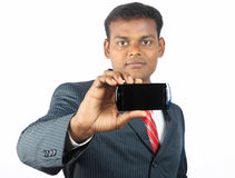 Buiness Man Shows a Smartphone Royalty Free Stock Photography