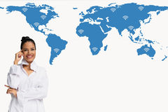 Buiness women thinking on world map network and wireless communication network. Buiness woman thinking on world map network and wireless communication network Royalty Free Stock Photography