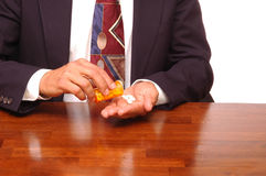 Buinessman Pouring Pills into hand Stock Photos