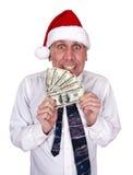 Buinessman Weihnachtsgratifikation-Weihnachtsmann-Hut-Geld Stockfotos