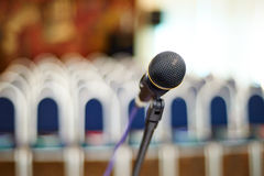 Buiseness auditory. Close up photo of mikrophone on the business auditory background stock photos
