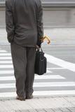 Buisiness man waiting at crosswalk Stock Image