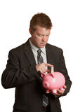 Buisinessman saving piggy bank Stock Image