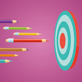 Buisness Targeting. Colored pencils flying at the target. Education and business concept Royalty Free Stock Photo
