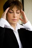 Buisness woman having headache Stock Photo