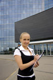 Buisness woman near the modern building. Stock Photo