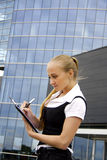 Buisness woman near the office building. Royalty Free Stock Image