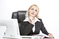 Buisness Woman working. Buisness Woman working in her office Royalty Free Stock Photo
