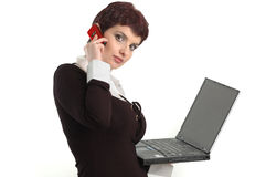 Buisness women with laptop and mobile phone. Young beautiful model with laptop and mobile phone Stock Photography