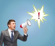 Buisnessman with bullhorn or megaphone Royalty Free Stock Image