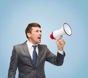 Buisnessman with bullhorn or megaphone. Business, communication, hiring, searching, public announcement, office concept - buisnessman with bullhorn or megaphone Royalty Free Stock Photography
