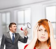 Buisnessman with bullhorn and stressed woman Royalty Free Stock Photography