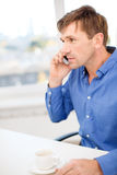 Buisnessman with cell phone and cup of coffee Royalty Free Stock Photos