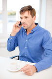 Buisnessman with cell phone and cup of coffee Stock Photo