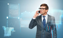 Buisnessman with cell phone and forex chart. Business, money, technology and office concept - buisnessman with cell phone and forex chart Royalty Free Stock Images