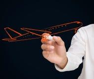 Buisnessman dessinant l'avion orange Photos libres de droits