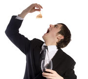 Buisnessman is eating a seafood. A buisnessman is eating a seafood and hold a glass of wine. Isolated on white royalty free stock photos