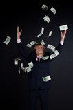 Buisnessman and falling down money Stock Photography
