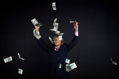 Buisnessman and falling down money Stock Photos